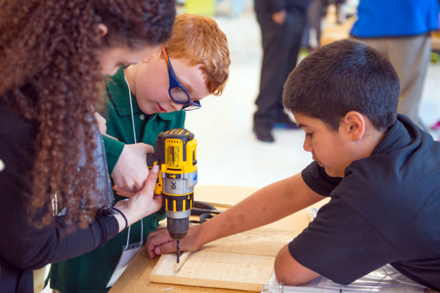 """Associate Monica M. assists future engineers with their """"drill skills""""!"""