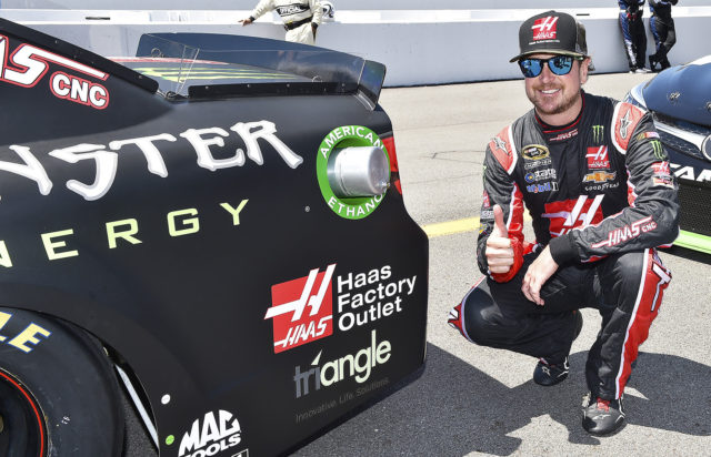 Kurt Busch posing with his winning car, #41